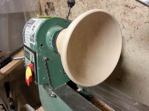 The bowl has been hollowed and sanded, but still on the lathe.